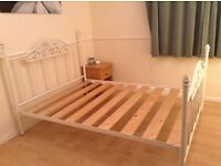 Smart white metal double bed frame with slats