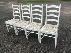 Four ladder back dining chairs