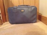 "Sky blue vinyl hand suitcase, used once. Size 24"" x 16"" x 7 and 1/2""."