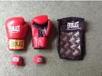 REDUCED! Grab a bargain. Red leather boxing gloves and wrist wraps.