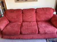 Two red sofas in good condition for urgent sale