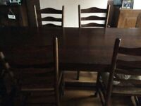 Solid dark oak antique distressed 7ft refectory table and 6 chairs, vgc, house move forces sale.