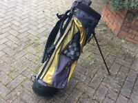Golf bag with balls, tees and umbrella