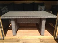 Dining table: Large rectangular Grey Rattan with glass top.