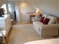 Annexe studio with separate, fully fitted kitchen.