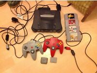 N64 console, 2original controllers, 4 games, 2 rumble packs