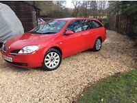 Nissan Primera; diesel 5 door in red. Good powerful runner with 4 months MOT