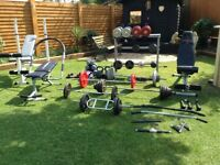 400Kg cast iron free weights, 3 benches, dumb bells, kettle bells, rack, bars, multi gym, ropes.