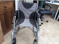 NEW Lightweight Wheelchair, used twice, easy fold down for storage, very comfortable.