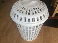 White plastic laundry bin with lid
