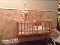 Mothercare pine swinging crib and bedding set.