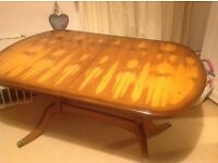 Beautiful, extendable, yew wood dining table. Seats 6 to 8 people, although has sat 10.