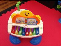Fisher Price grand piano activity table