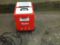 Car valeting machine and hoses with heater .