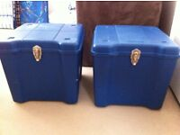 Two hard plastic storage boxes.