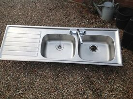 Double sink including taps and drainer
