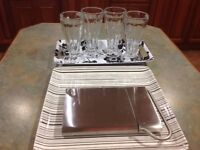 Trays, tall glass sundae dishes, cheese slice.
