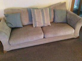 2 cream fabric sofas,