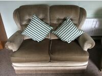 2 seater sofa, armchair and footstool upholstered in light olive Draylon. Reasonable condition.