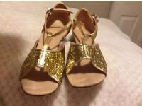 Glittery gold juvenile ballroom shoes. Brand new