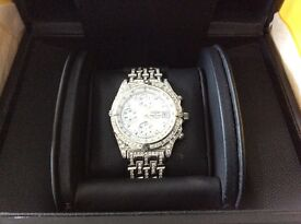 Gents brietling fully loaded with diamonds,comes in box,manuals,valuations,fully serviced,