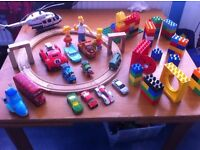Train trucks with trains wooden bricks,cars,bus,Helicopter and Lego only for £5