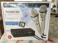 Karaoke set with two microphones and DVD. Brand new in box.