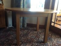 Dining table wooden, 4' diameter approx, excellent condition, seats 4 comfortably.