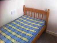 Single pine beds with mattresses