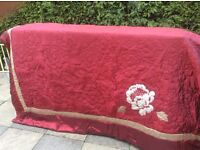 Two red king size quilted bed throws