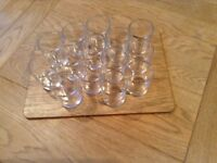 14 thick clear glass tea light holders, mainly unused