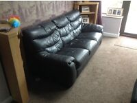 Three seater sofa and matching electric recliner chair - black leather and in good condition