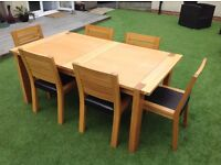 Solid wood extendable table & six chairs from Marks & Spencer