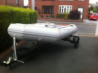 New Inflatable boat on trailer