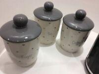 Grey and cream tea coffee and sugar jars