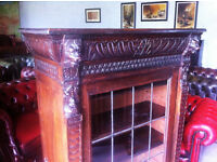 Heavily carved oak bookcase with lead glazed door