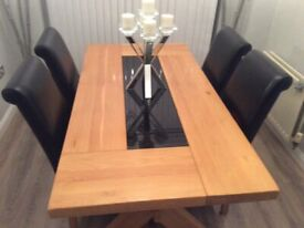 Solid oak dining table with glass inlay and 4 chairs