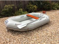 West line 230 inflatable dinghy. Flat inflatable floor. Excellent condition. Includes oars and pump