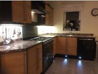 Stunning 7 year old Magnet, wood with black gloss kitchen units plus extras immaculate conditi
