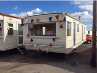 Cheap caravan sited on st.0syth holiday park,seawick,essex,clacton on sea FREE CREDIT CHECK