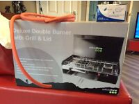 Delux double lpg burner with grill and lid. Never used and complete with regulator, hose and clips