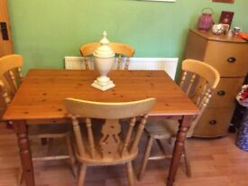 Pine table and four fiddle back chairs