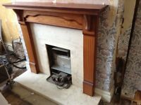 Wood effect fire surround with marble hearth and back panel.