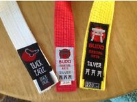 3 karate belts , as new condition