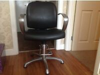 Hairdressers/Beautician chair, black leather and stainless steel arms, pump action lever to heighten