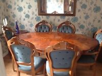 Dining table and six chairs with display cabinets