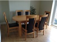 Extending oak dining table and six chairs very good quality, built to last, good condition