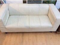 A Set Of Two Sofas