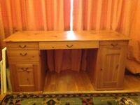 A pine five drawer desk