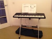 Large Casio Keyboard complete with stand